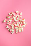 Popcorn on pink background Royalty Free Stock Photos
