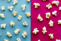 Popcorn on pink and blue background stock photo