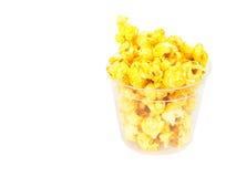 Popcorn in plastic bucket on white background Stock Photos