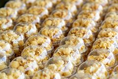 Popcorn in a plastic cup is beautifully placed. Unhealthy food or snack concept. Tasty salty popcorn. Carbohydrates food. Junk. Food. Popcorn on plastic glass royalty free stock photos