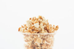 Popcorn in plastic cup on white background. Royalty Free Stock Photography