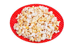 Popcorn on a plate isolated on white Stock Photos