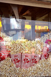 Popcorn popper machine. Freshly popped corn in bags is a favorite at movies and fairs Royalty Free Stock Photo