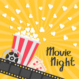 Popcorn popping. Big movie reel. Ticket Admit one. Three star. Cinema movie icon in flat design style. Film strip border. Red yell. Ow strip box. Yellow star Stock Images