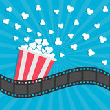 Popcorn popping. Cinema movie icon in flat design style. Film strip border. Red yellow strip box. Blue star burst sunburst wave ba. Ckground Vector illustration Stock Photography