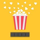 Popcorn popping. Film strip. Red yellow box. Cinema movie night icon in flat design style. Yellow background. Royalty Free Stock Photos