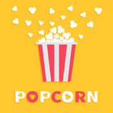 Popcorn popping. Red yellow strip box package. Cinema movie night icon Flat design style. Fast food. Yellow background Red white t. Ext. Vector illustration Royalty Free Stock Photo