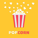 Popcorn popping. Red yellow strip box package. Cinema movie night icon in flat design style. Fast food. Yellow background. Popcorn popping. Red yellow strip Stock Photos
