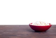 Popcorn in a pot on the table isolated on white background Stock Image