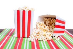Popcorn in a pot on the table isolated on white background Stock Photography