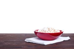 Popcorn in a pot on the table isolated on white background Stock Images