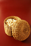 Popcorn on red background with basket Stock Image