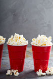 Popcorn in red cups Royalty Free Stock Image