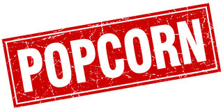 Popcorn red square grunge stamp. On white Royalty Free Stock Photo