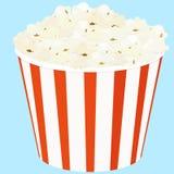 Popcorn in a red striped bucket box. Popcorn in a red and white striped bucket box Stock Image
