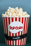 Popcorn in red striped cardboard box for cinema Stock Photography