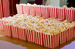 Popcorn box for the movies. Popcorn in red and white cardboard box ready for the movies Stock Images