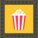 Popcorn. Red yellow box. Film strip square frame. Cinema movie night icon in flat design style. Yellow background. . Stock Image