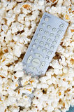 Popcorn and remote control Stock Photos