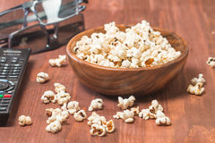 Popcorn, remote control and 3D glasses Royalty Free Stock Photos
