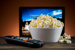 Popcorn and a remote control Royalty Free Stock Photos