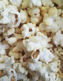 Popcorn salty background. Fluffy refreshment Stock Images