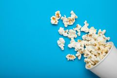 Popcorn, scattered from a white cup. Copy space royalty free stock photos