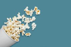 Popcorn, scattered from a white cup. Copy space stock photos