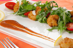 Popcorn Shrimp and Baby Arugula Salad Stock Photo