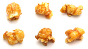 Popcorn. Six pieces of popcorn on a white background Stock Photography
