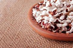 Popcorn Snack in the Ceramics Saucer Stock Images