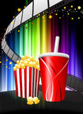 Popcorn and Soda on Abstract Spectrum Background Royalty Free Stock Photo