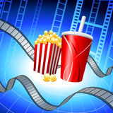 Popcorn and Soda on Film Strip Background Stock Images