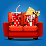Popcorn and soft drink eating popcorn Royalty Free Stock Image