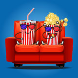 Popcorn and soft drink wear 3D glasses and eating popcorn Royalty Free Stock Photography