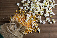 Popcorn spilled out of the jute bag Stock Images