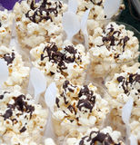 Popcorn sprinkled with chocolate sauce Stock Images