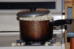 Popcorn on the stove Stock Photos