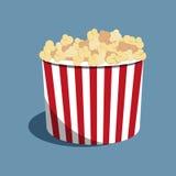 Popcorn striped bucket full of popcorn. Vector Illustration. Cinema food on the blue background. Popcorn striped bucket full of popcorn. Red and white stripes on Stock Image