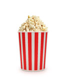 Popcorn in striped bucket Royalty Free Stock Images