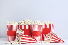 Popcorn in striped buckets and paper bag