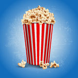 Popcorn. Striped carton bowl filled of popcorn Royalty Free Stock Image