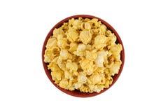 Popcorn sul fondo dell'isolato nella vista superiore Fotografia Stock