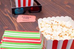 Popcorn on the table movie tickets, 3D glasses top view. Popcorn on  table movie tickets, 3D glasses top view Stock Photos
