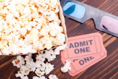 Popcorn on the table movie tickets, 3D glasses top view Royalty Free Stock Photo