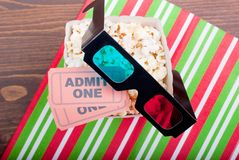 Popcorn on the table movie tickets, 3D glasses top view Stock Photos