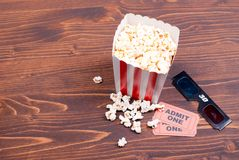 Popcorn on the table movie tickets, 3D glasses top view. Popcorn on  table movie tickets, 3D glasses top view Stock Photography