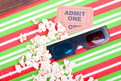 Popcorn on the table movie tickets, 3D glasses top view. Popcorn on  table movie tickets, 3D glasses top view Stock Photo