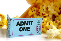 Popcorn and ticket. Ticket stub and bag of popcorn closeup Stock Photos