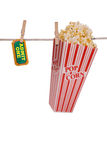 Popcorn and ticket hanging on Royalty Free Stock Photo